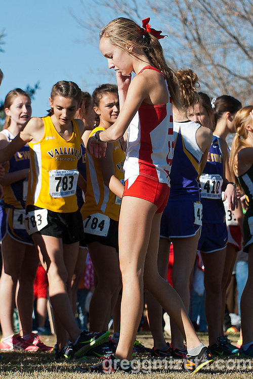 Boise junior Emily Hamlin checks her watch before the start of the Idaho High School Cross Country State 5A Championships on November 2, 2013 at Freeman Park in Idaho Falls, Idaho. <br /> <br /> Hamlin, two time and defending state champion, finished fourth (19:28.64) behind Mountain View senior Sam McKinnon (18:26.31), Vallivue junior Mikayla Malaspina (19:05.51) and Coeur d'Alene sophomore Emily Callahan (19:14.03).