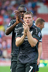 STOKE-ON-TRENT, ENGLAND - Sunday, August 9, 2015: Liverpool's James Milner and Christian Benteke applaud the supporters after the 1-0 victory over Stoke City during the Premier League match at the Britannia Stadium. (Pic by David Rawcliffe/Propaganda)
