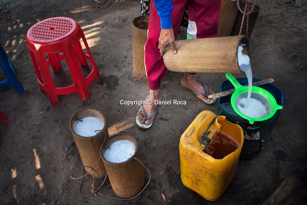 Straining the freshly collected sap to boil it down afterwards. At Ka Myaw Gyi village in the outskirts of Dawei, Myanmar.