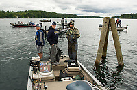 The Bow Falcons make their way to the docks at Center Harbor after a day of fishing on Lake Winnipesaukee during the NHIAA State Qualifier on Thursday.  (Karen Bobotas/for the Laconia Daily Sun)