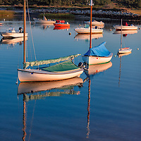Boats at anchor, on a very calm morning, in Truro Harbor. Near Cape Cod National Seashore, Massachusetts