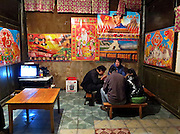 Dinner at the one guesthouse in Xidang Springs under propaganda posters. Xidang Springs is the last stop on the road to access Yubeng village and the mountains around Kawagarbo and Miacimu.