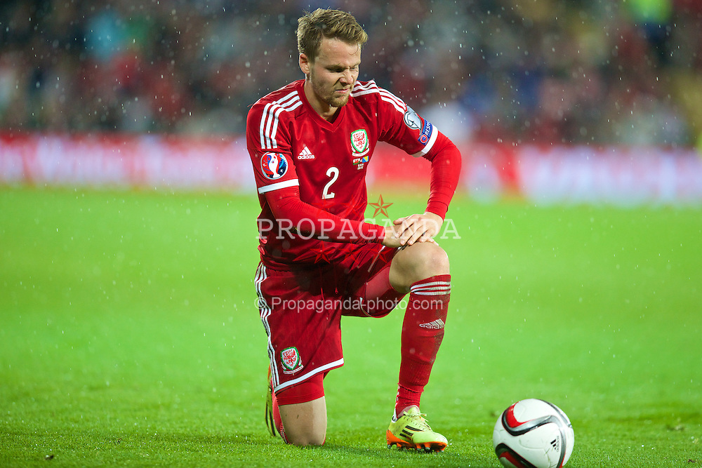 CARDIFF, WALES - Friday, October 10, 2014: Wales' Chris Gunter in action against Bosnia and Herzegovina during the UEFA Euro 2016 qualifying match at the Cardiff City Stadium. (Pic by David Rawcliffe/Propaganda)