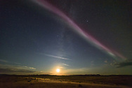 "It was nearly 11pm in southern Saskatchewan. I had just watched a bright auroral substorm send colorful arcs high into the northern sky, but it was starting to fade. Then I turned around, looking south, and this is what I saw. A bright pinkish strip of light stretched from east to west, while the crescent moon hung low on the horizon. It's one of the most unusual things I've ever seen in the night sky. This strange type of aurora is called Steve. The name started as a joke, but it stuck.  Steve was first captured last year by a group of aurora photographers in Alberta. After ESA flew a satellite through it earlier this year, it was discovered that it's comprised of very hot (10,800°F) ionized gases moving along at 4 miles per second. This ribbon of light is 16 miles wide and thousands of miles long. I watched as Steve started overhead nearly paralleling the US-Canada border, before slowly moving south. It turned into a green ""picket fence"" pattern before fading away. It was awesome to see such a mysterious phenomena which is still being studied by scientists."