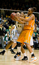 December 22, 2009; San Francisco, CA, USA; San Francisco Dons forward Bailey Barbour (44) battles with Tennessee Lady Volunteers center Kelley Cain (52) for a rebound during the first half at War Memorial Gym.  Tennessee defeated San Francisco 89-34.