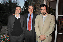 Left to right, EDWARD GLASS, CHARLES GLASS and GEORGE GLASS at a party to celebrate the publication of Charles Glass's new book 'Americans in Paris' held at 12 Lansdowne Road, London W1 on 25th March 2009.