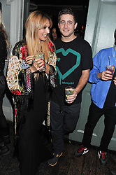 ZARA MARTIN and TYRONE WOOD at a carnival themed party hosted by Stacey Bendet for the Alice & Olivia fashion label at Paradise, Kensal Green, London on 9th November 2011