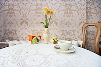 Coffee cup with vase on cafe table