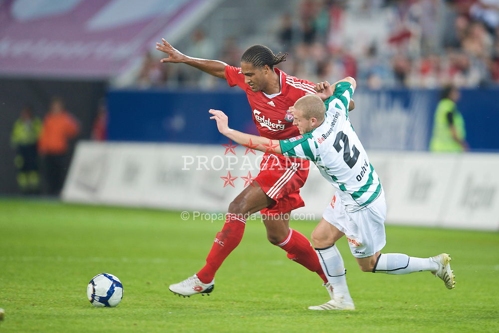 ST GALLEN, SWITZERLAND - Wednesday, July 15, 2009: Liverpool's Glen Johnson and St Gallen's Yves Oehri during their opening preseason friendly match at the AFG Arena. (Pic by David Rawcliffe/Propaganda)