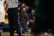 Milpitas head coach Champ Wrencher signals a thumbs up to his team during a quad game against Palo Alto at Milpitas High School in Milpitas, California, on January 31, 2014.  Milpitas beat Palo Alto 51-39. (Stan Olszewski/SOSKIphoto)