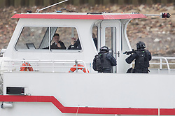 © Licensed to London News Pictures.19/03/2017.London, UK. Armed police take control of a cruise boat during an ant-terrorist training exercise on The River Thames in London. It is the first time that an exercise of this type has taken place on the river.Photo credit: Peter Macdiarmid/LNP