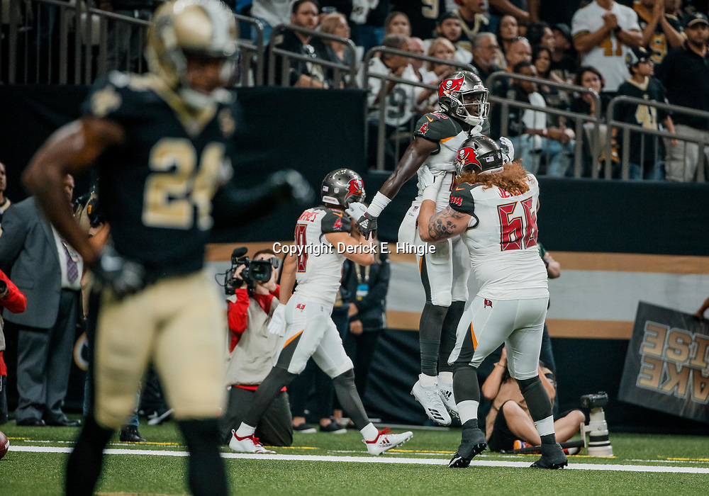 Sep 9, 2018; New Orleans, LA, USA; Tampa Bay Buccaneers wide receiver Chris Godwin (12) celebrates with center Ryan Jensen (66) after a touchdown during the second quarter of a game at the Mercedes-Benz Superdome. Mandatory Credit: Derick E. Hingle-USA TODAY Sports