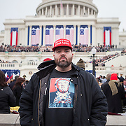 "Daryl Bowler, traveled from Orange County, CA to attend the Inauguration of Donald Trump as the 45th President of the United States, January 20, 2017.  While he originally supported Rand Paul, he said the last thing he wanted was another Clinton in office.  When asked about his hopes for the Trump administration he replied, ""I hope the world doesn't burn down...""  But as a railroad worker dependent on the coal industry he added, ""...I hope he brings jobs back.  Hillary said she'd kill coal and that would've put me out of work...""  John Boal Photography"