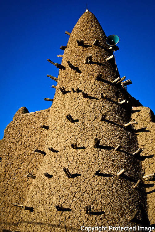 TIMBUKTU, MALI - NOVEMBER 14 : Djingareiber mosque, built in 1325 by the Andalucian architec and poet Es Saheli,  on November 14, 2007 in Timbuktu, Mali . In the  Middle Ages  Timbuktu was the centre of the cultural world of black Africa, thanks to the merchants who came to the oasis and not just transporting goods but also manuscripts and books from across the Mediterranean and the Middle East that were copied and distributed.