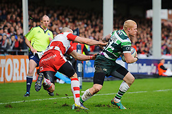 London Irish Full Back (#15) Tom Homer runs the ball out under pressure from Gloucester Winger (#14) Charlie Sharples during the first half of the match - Photo mandatory by-line: Rogan Thomson/JMP - Tel: Mobile: 07966 386802 15/12/2012 - SPORT - RUGBY - Kingsholm Stadium - Gloucester. Gloucester Rugby v London Irish - Amlin Challenge Cup Round 4.