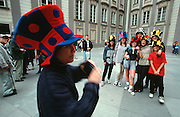 Tourists making souvenir photos with funny hats at the Hrad (castle), in front of St. Vitus Dome.