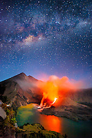 Mount Rinjani, a 3,726-meter volcano in Lombok, Indonesia, erupts under the Milky Way in a night sky. Travel photography by Djuna Ivereigh.
