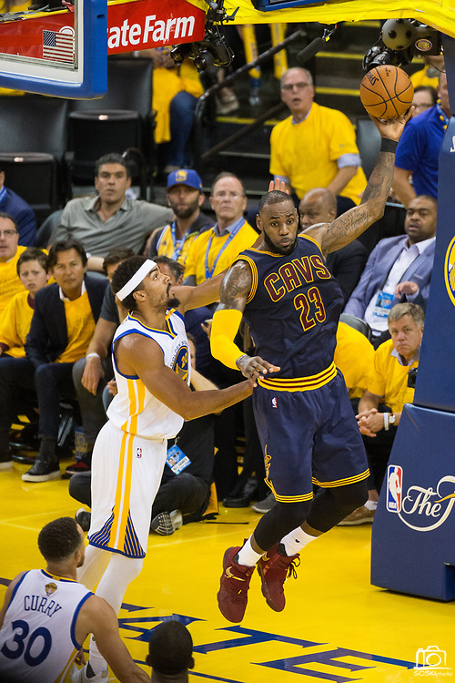 Cleveland Cavaliers forward LeBron James (23) snags a loose ball against Golden State Warriors forward James Michael McAdoo (20) during Game 1 of the NBA Finals at Oracle Arena in Oakland, Calif., on June 1, 2017. (Stan Olszewski/Special to S.F. Examiner)