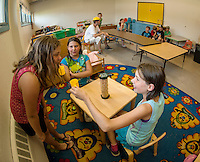 "Children gather in the rooms of the Boys and Girls Club of the Lakes Region as they begin their first week in their new ""home"" on North Main Street in Laconia.  (Karen Bobotas/for the Laconia Daily Sun)"