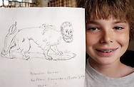 READING, PA - JULY 15: Brandon Reimer, of Reading, Pennsylvnaia, winner of the New York Post Harry Potter contest holds up his sketch that helped him win the contest July 15, 2005 in Reading, Pennsylvania. (Photo by  William Thomas Cain)