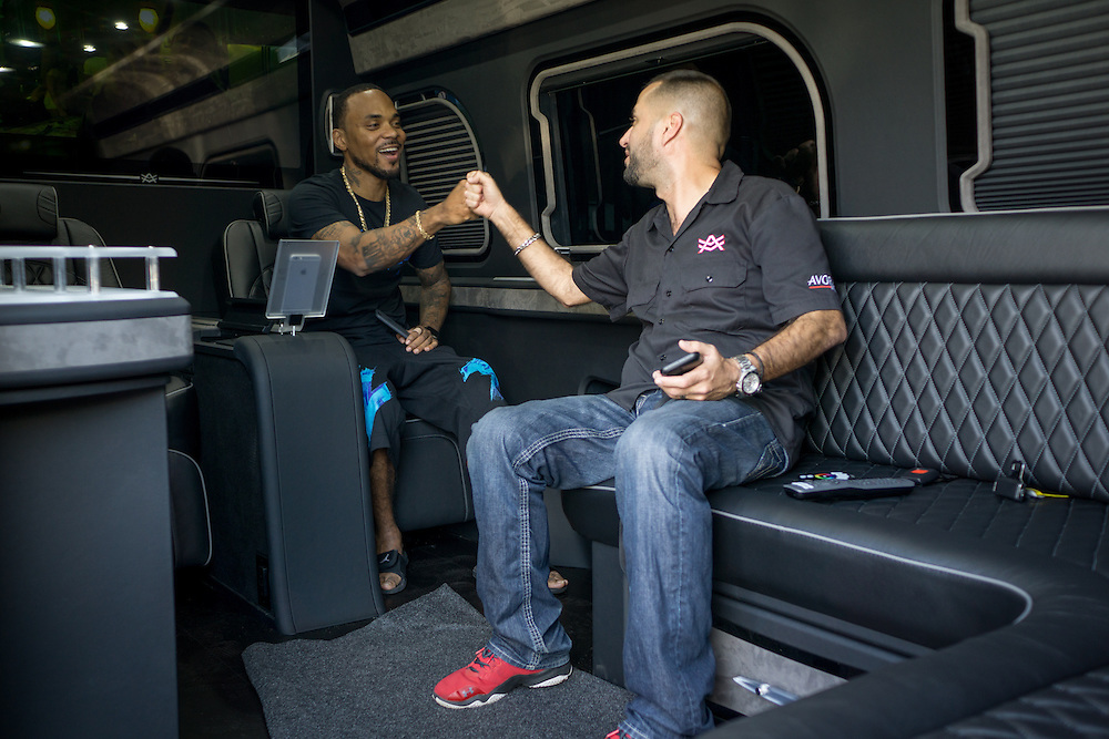 DORAL, FLORIDA, DECEMBER 11, 2015<br /> Alex Vega, right, owner of The Auto Firm, a South Florida car customizing and restoring shop which has a vast clientele of professional athletes and entertainers,  fist bumps Atlanta rapper Peeto the Plug after showing him a customized Mercedes Benz limo van. The van sells for $175.000.<br /> (Photo by Angel Valentin/Freelance)