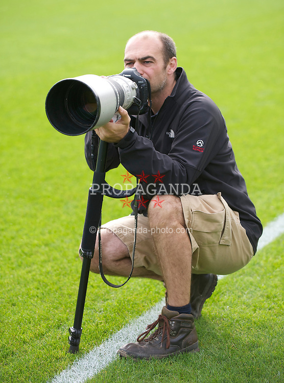 CARDIFF, WALES - Thursday, October 7, 2010: Photographer Nick Potts from the Press Association covers the action during a training session at the Vale of Glamorgan ahead of the UEFA Euro 2012 Qualifying Group G match against Bulgaria. (Pic by David Rawcliffe/Propaganda)