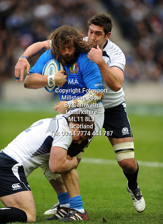 Italy prop Martin Castrogiovanni is wrapped up by Nathan Hines and Ross Ford.<br /> Scotland v Italy, Six Nations Championship, Murrayfield, Edinburgh, Scotland, Saturday 19th March 2010.<br /> Please credit ***FOTOSPORT/DAVID GIBSON***
