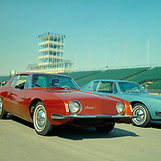 Two Studebaker Avantis at the Indianapolis Motor Speedway in October of 1962.  Andy Granatelli (driving) and Sherwood Egbert (pass) are in the red Avanti.