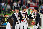 Podium Grand Prix Special 1. Charlotte Dujardin and Valegro, 2. Helen Langehanenberg and Damon Hill, 3 Kristina Sprehe and Desperados <br /> Alltech FEI World Equestrian Games™ 2014 - Normandy, France.<br /> © DigiShots