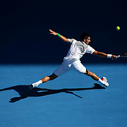 MELBOURNE, AUSTRALIA - JANUARY 19:  Novak Djokovic of Serbia plays a backhand in his fourth round match against Fabio Fognini of Italy during day seven of the 2014 Australian Open at Melbourne Park on January 19, 2014 in Melbourne, Australia.  (Photo by Chris Hyde/Getty Images)