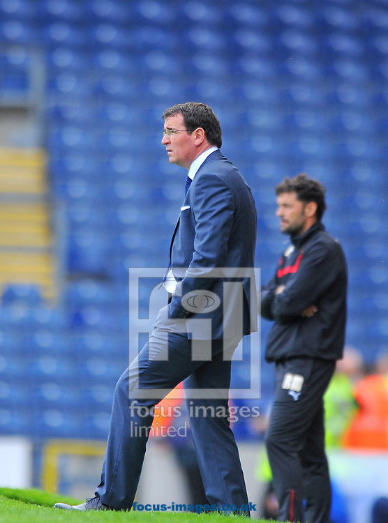 Blackburn Rovers manager Gary Bowyer (front) during the Sky Bet Championship match at Ewood Park, Blackburn<br /> Picture by Greg Kwasnik/Focus Images Ltd +44 7902 021456<br /> 27/09/2014