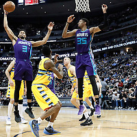 04 March 2017: Charlotte Hornets guard Jeremy Lamb (3) grabs a rebound next to Charlotte Hornets forward Christian Wood (35) during the Charlotte Hornets 112-102 victory over the Denver Nuggets, at the Pepsi Center, Denver, Colorado, USA.