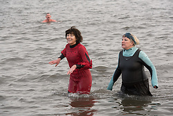 In an impromptu celebration of the New Year, intrepid bathers took a plunge in the icy water at Portobello Beach this lunchtime, watched by crowds of spectators.<br /> <br /> <br /> © Jon Davey/ EEm