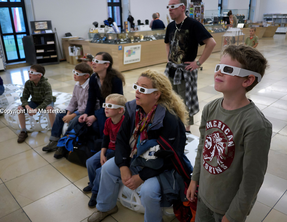 Visitors watch 3D film with 3D glasses at the Deutsches Bergbau-Museum or German Mining Museum in Bochum Germany