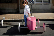 """Haley McKernan, 8, lays a hand on her soap box racing car """"Haley's Comet"""" before the start of her first competition on June 8, 2008. Her father and grandfather helped her build the car including the recent paint job with her favorite color, pink."""