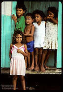 Kids stand in doorway of home at Seringal Mourao, failed rubber tapper community on Eiru River. Brazil