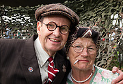 Steve &amp; Denise Stoakes of Grimsby dressed as a 1940's ARP warden &amp; &quot;Char Lady&quot;.<br /> 1940's Weekend<br /> Lincolnshire Wolds Railway<br /> Ludborough station, <br /> Nr Grimsby <br /> Lincolnshire