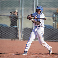 Laguna Acoma Hawk Dwight Fernando (14) hits the ball during the game against McCurdy Wednesday in Laguna.