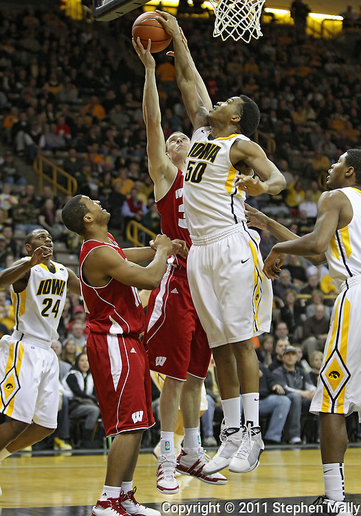 February 09 2011: Iowa Hawkeyes forward Jarryd Cole (50) blocks a shot by Wisconsin Badgers forward Jon Leuer (30) during the first half of an NCAA college basketball game at Carver-Hawkeye Arena in Iowa City, Iowa on February 9, 2011. Wisconsin defeated Iowa 62-59.