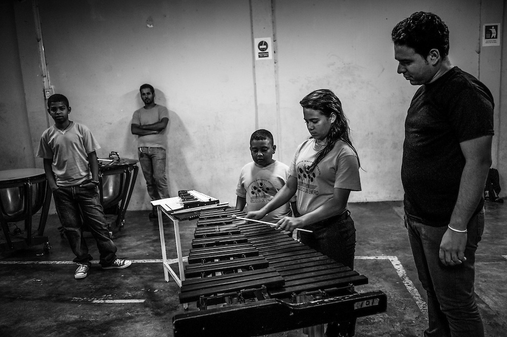 Students learn to play classical music at the 23 de Enero nucleo, of the El Sistema music program. 23 de Enero slum is the stronghold of late socialist President, Hugo Chavez. It is where his armed, militant supporters live, and is indisputedly the heart of the Revolution in Venezuela.