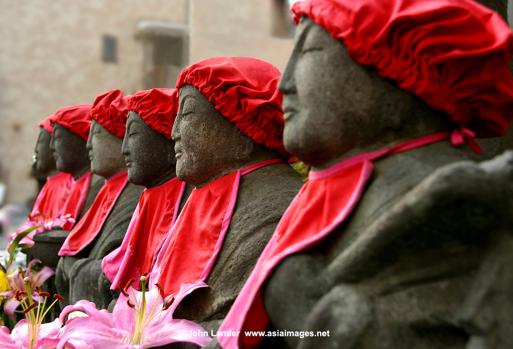 """""""Roku Jizo"""" or 6 Jizo are set at a major intersection in the town of Kamakura - Jizo images and statues are popular in Japan as Bodhisattva who console beings awaiting rebirth and travelers.  They are often found along roadsides, paths or even street corners."""