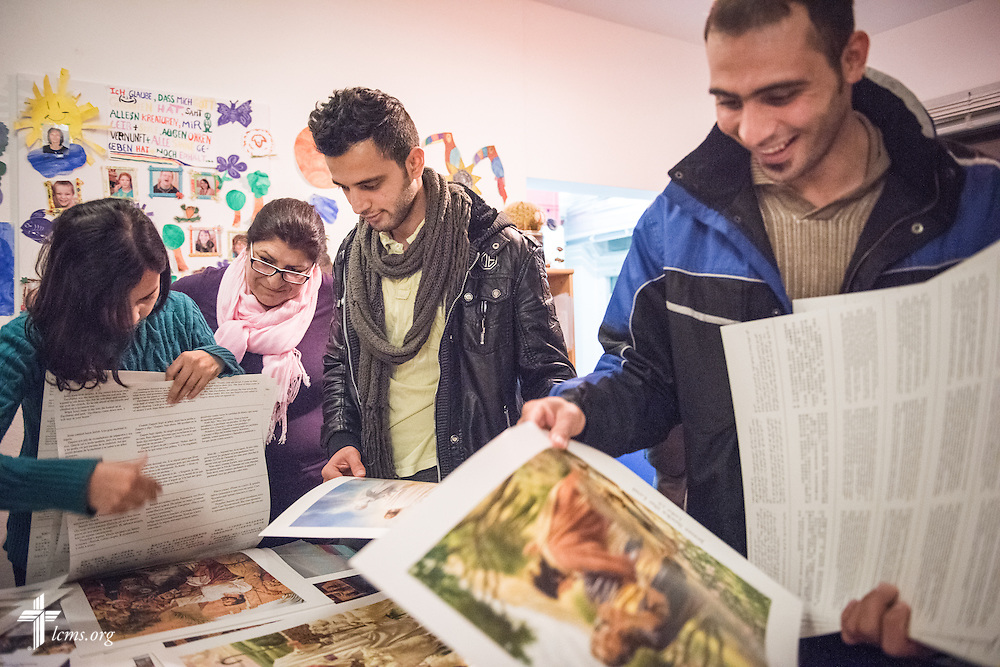 Iranian refugees pick out posters from Concordia Publishing House following a Bible study on Friday, Nov. 13, 2015, near the Evangelisch-Lutherische St. Trinitatisgemeinde, a SELK Lutheran church in Leipzig, Germany. LCMS Communications/Erik M. Lunsford