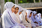 26 OCTOBER 2012 - PULASAIZ, NARATHIWAT, THAILAND:   Women at Eid al-Adha services at the mosque in the villiage Pulasaiz, in the province of Narathiwat, Thailand. Eid al-Adha, also called Feast of the Sacrifice, is an important religious holiday celebrated by Muslims worldwide to honor the willingness of the prophet Ibrahim (Abraham) to sacrifice his firstborn son Ishmael as an act of submission to God, and his son's acceptance of the sacrifice before God intervened to provide Abraham with a ram to sacrifice instead. In 2012 Eid al-Adha was celebrated Oct 25 - 26.   PHOTO BY JACK KURTZ