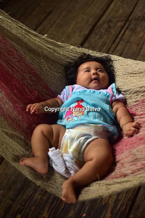 Female bribri baby (Simea) in handmade hammock inside a hut. <br /> <br /> A day with the Bribri, indigenous people in Lim&oacute;n Province of Costa Rica.