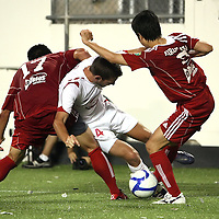 Orlando City Lions Midfielder Luke Boden (14) gets double teamed during a United Soccer League Pro soccer match between the Richmond Kickers and the Orlando City Lions at the Florida Citrus Bowl on May 25, 2011 in Orlando, Florida.  (AP Photo/Alex Menendez)