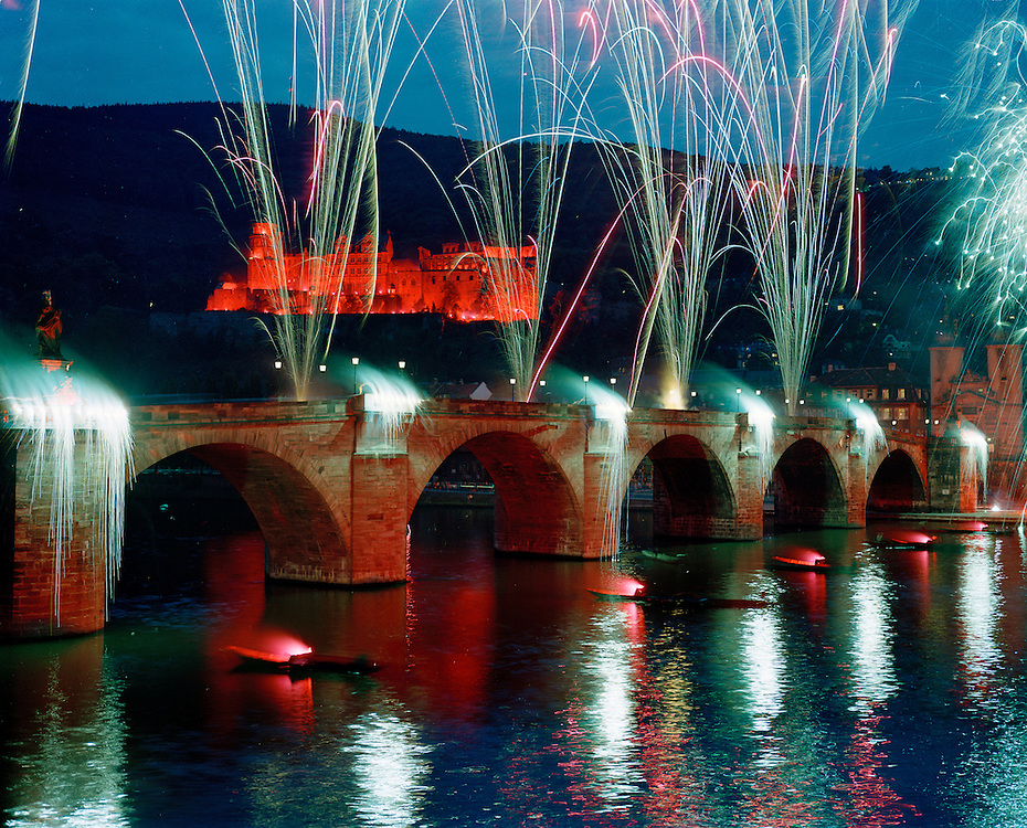"Fireworks are fired over the Neckar River from the Alta Brucke during the bi-annual commemoration of the ""Burning of the Schloss"" in Heidelberg, Germany."