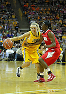 January 08 2010: Iowa guard Jaime Printy (24) tries to get around Ohio St. guard Amber Stokes (3) during the first half of an NCAA womens college basketball game at Carver-Hawkeye Arena in Iowa City, Iowa on January 08, 2010. Iowa defeated Ohio State 89-76.