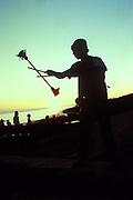A man with devil sticks at sunset, Ibiza, 1999.