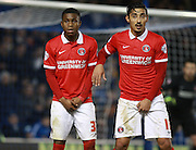 Charlton goalscorers Ademola Lookman & Reza Ghoochannejhad form a two-man wall during the Sky Bet Championship match between Brighton and Hove Albion and Charlton Athletic at the American Express Community Stadium, Brighton and Hove, England on 5 December 2015. Photo by Bennett Dean.