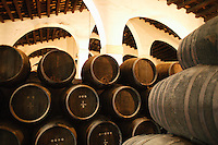 barrels of aging sherry in the cellars of the sherry makers Gonzalez Byass..April 2003